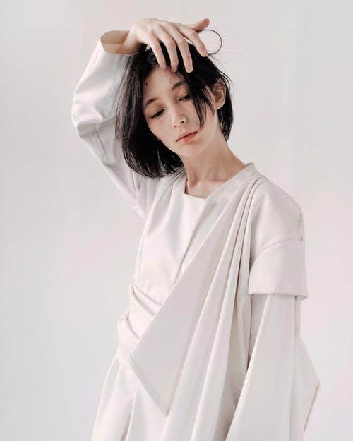 https://www.pexels.com/photo/woman-in-white-long-sleeved-dress-1030895/