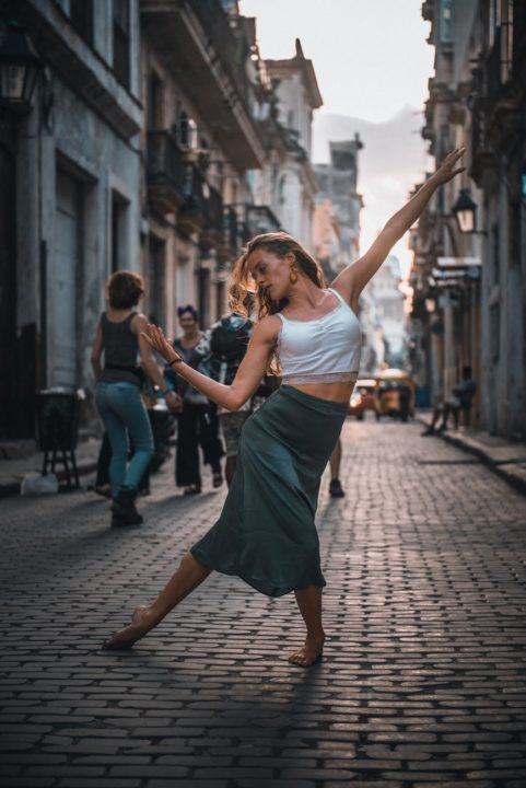 https://www.pexels.com/photo/photo-of-a-woman-dancing-on-a-street-2406676/