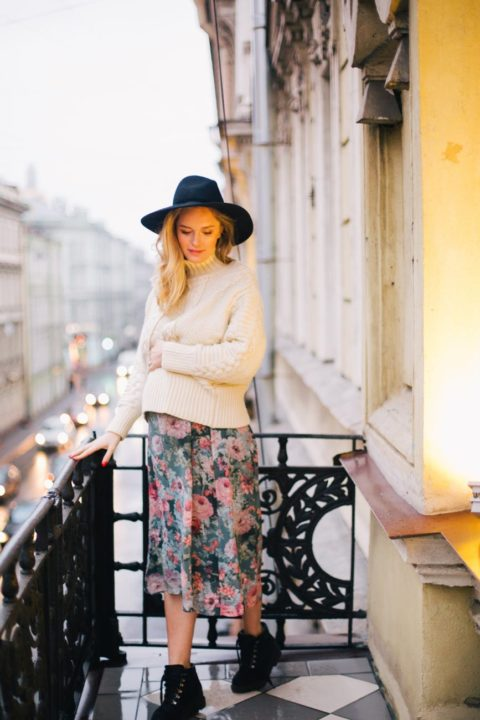 https://www.pexels.com/photo/pregnant-woman-wearing-white-sweater-and-multicolored-floral-skirt-standing-on-balcony-879805/