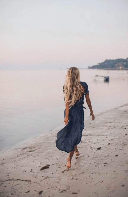 https://www.pexels.com/photo/photo-of-woman-walking-on-seashore-2072583/