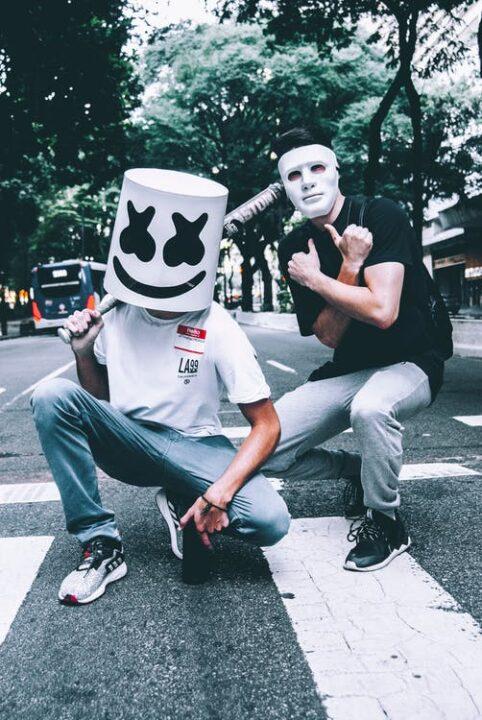 https://www.pexels.com/photo/photo-of-two-men-in-masks-squat-posing-1755829/