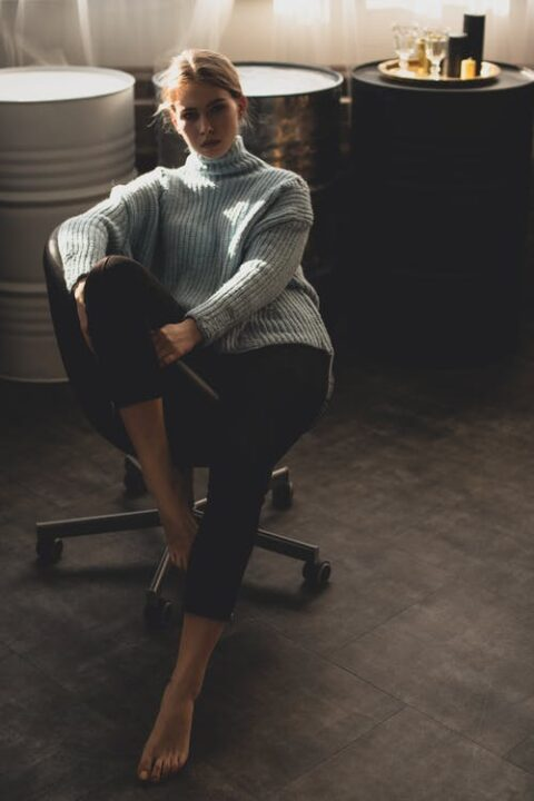 https://www.pexels.com/photo/woman-wearing-blue-sweater-and-black-pants-sitting-on-black-office-rolling-chair-3765545/