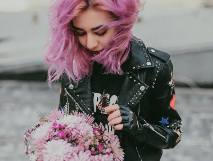 https://www.pexels.com/photo/woman-holding-flower-bouquet-1035682/