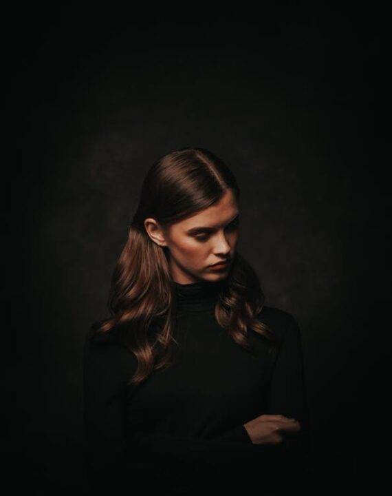 https://www.pexels.com/photo/photo-of-woman-in-black-turtleneck-sweater-posing-in-front-of-black-background-while-looking-away-3199036/
