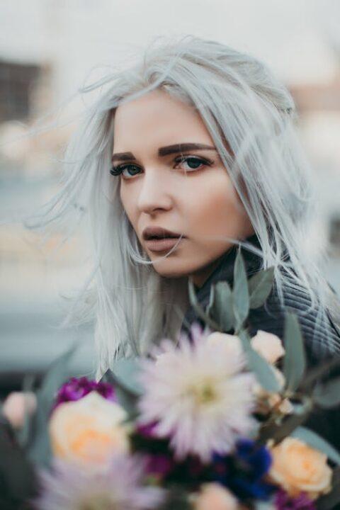 https://www.pexels.com/photo/woman-carrying-flowers-closeup-photo-1035688/