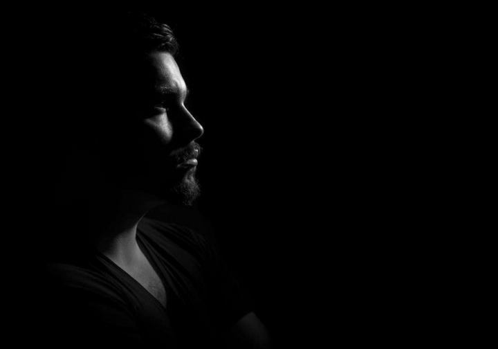 https://www.pexels.com/photo/grayscale-photo-of-man-in-black-v-neck-shirt-with-black-background-90764/