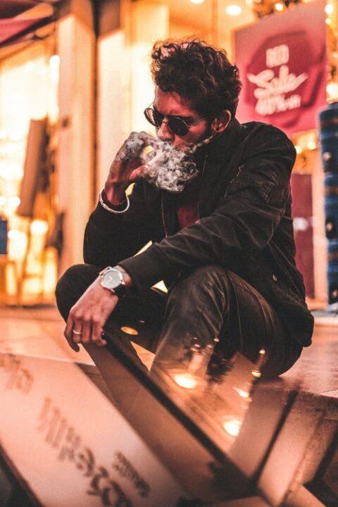 https://www.pexels.com/photo/man-in-black-jacket-and-black-pants-sitting-on-brown-wooden-floor-3718468/