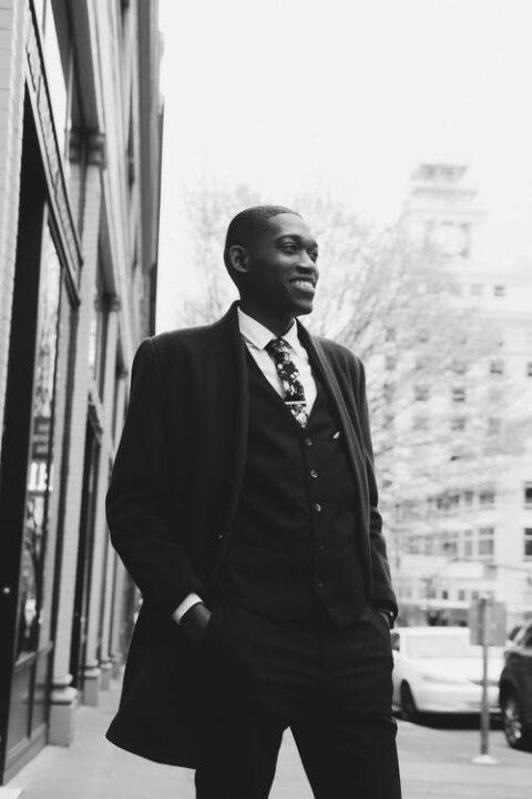 https://www.pexels.com/photo/black-stylish-man-in-suit-standing-on-street-4947748/